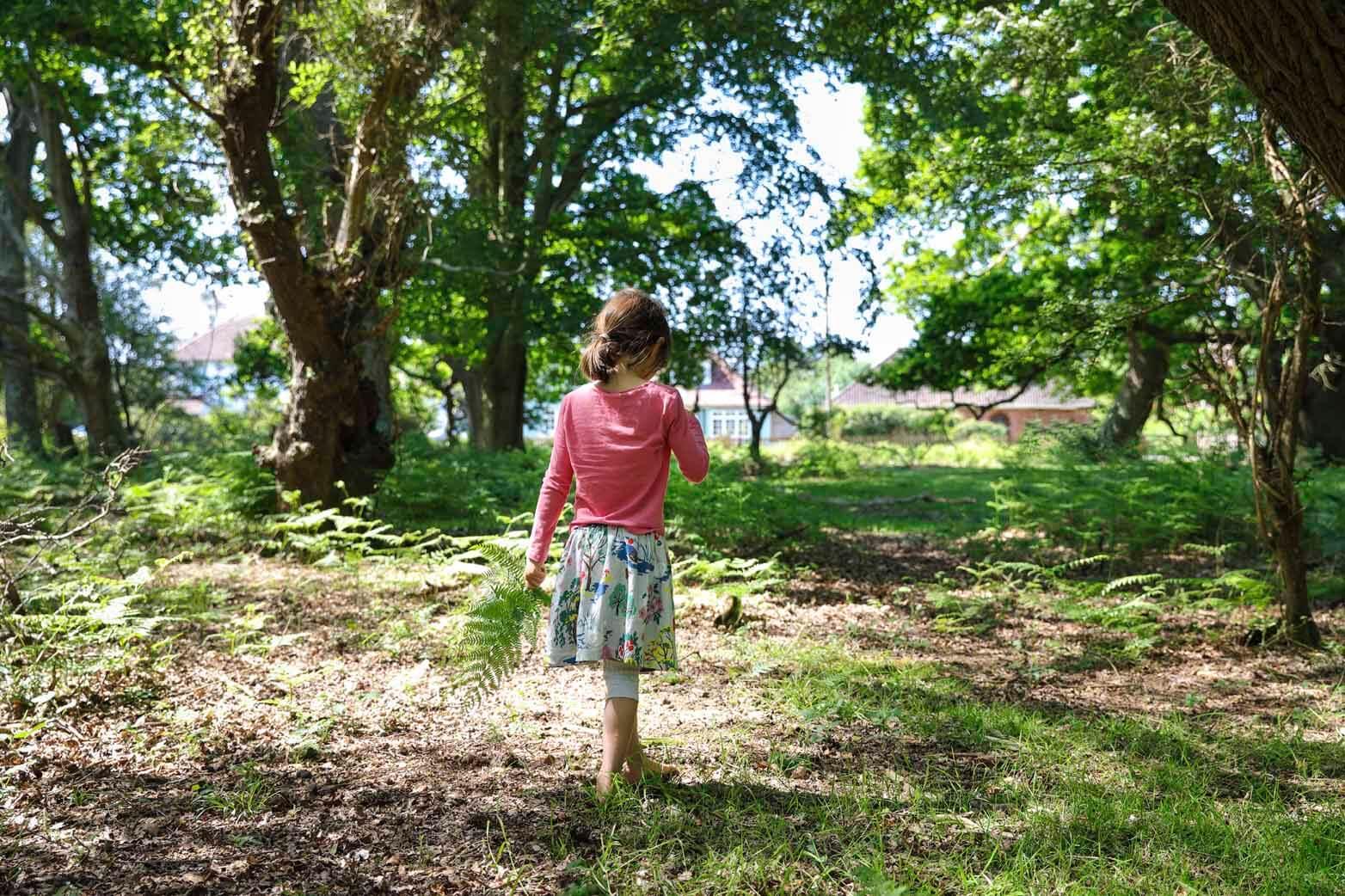 Dappled forest child walking